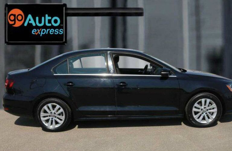 Exterior view of a black 2017 Volkswagen Jetta parked at the Go Auto Express dealership