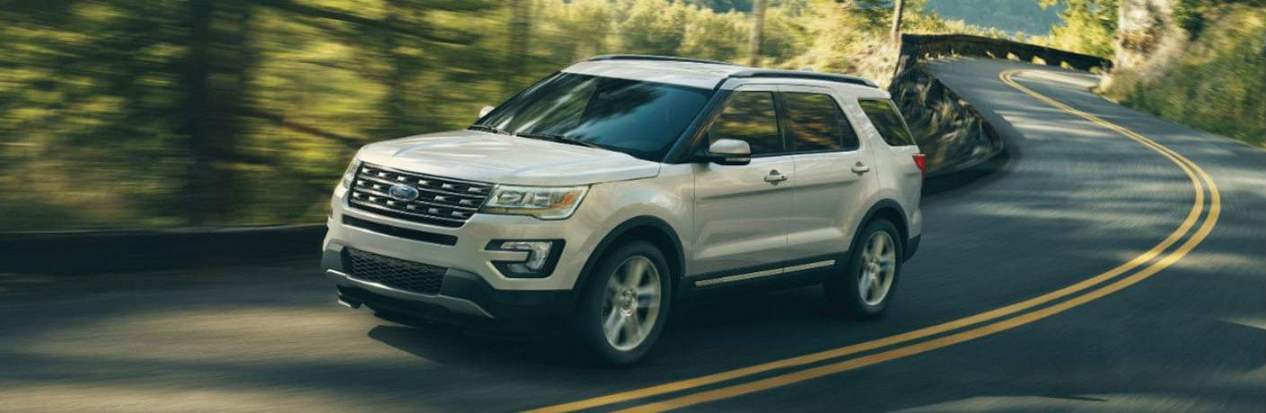 white 2017 Ford Explorer driving on highway exterior front driver side view
