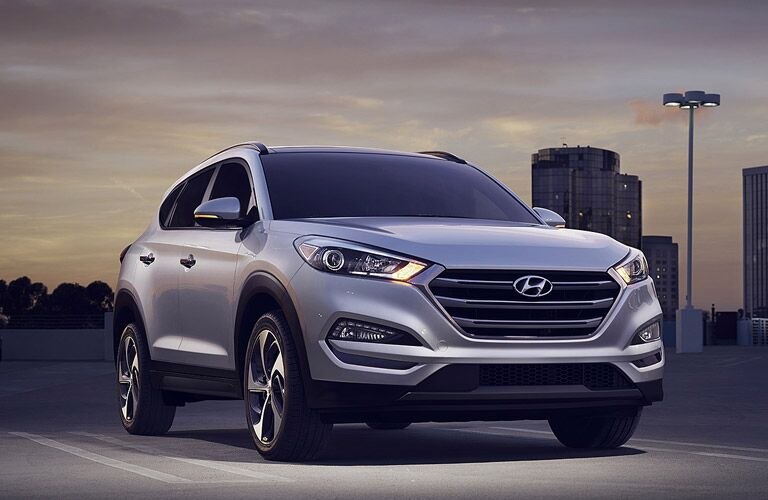 Exterior view of a gray 2017 Hyundai Tuscon parked in an empty parking lot