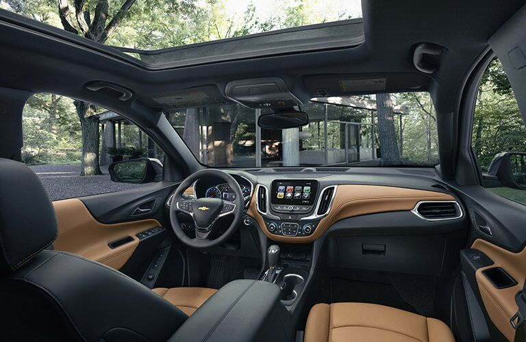 View of 2018 Chevy Equinox front interior with panoramic roof open