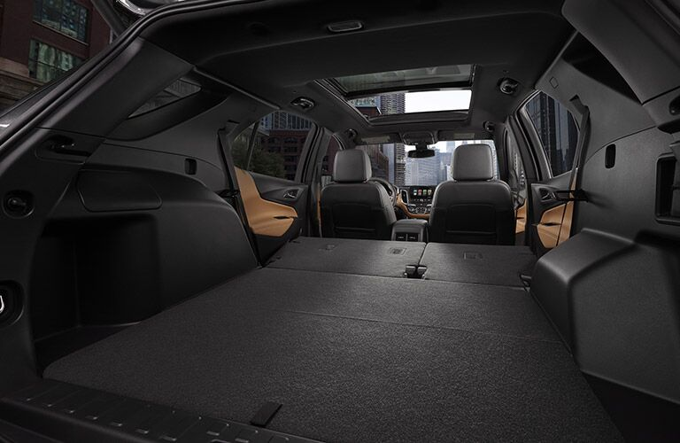 View of 2018 Chevy Equinox interior with rear seats folded down for more cargo space