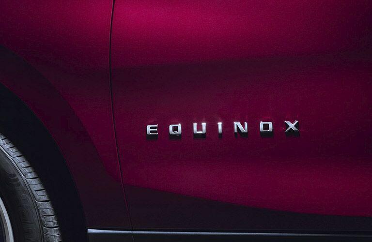 View of 2018 Chevy Equinox exterior door with Equinox badge displayed