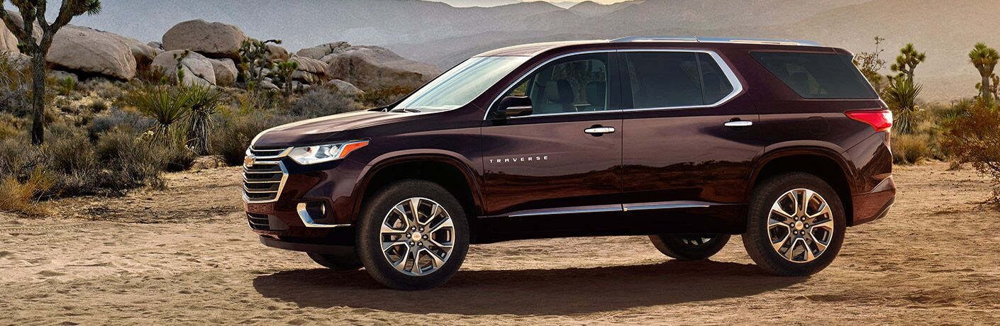 View of 2018 Chevy Traverse exterior parked on a dirt road with mountains in the background