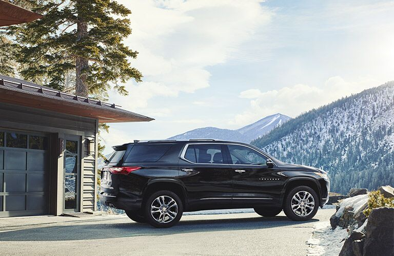 View of 2018 Chevy Traverse exterior from passenger side with mountain in background