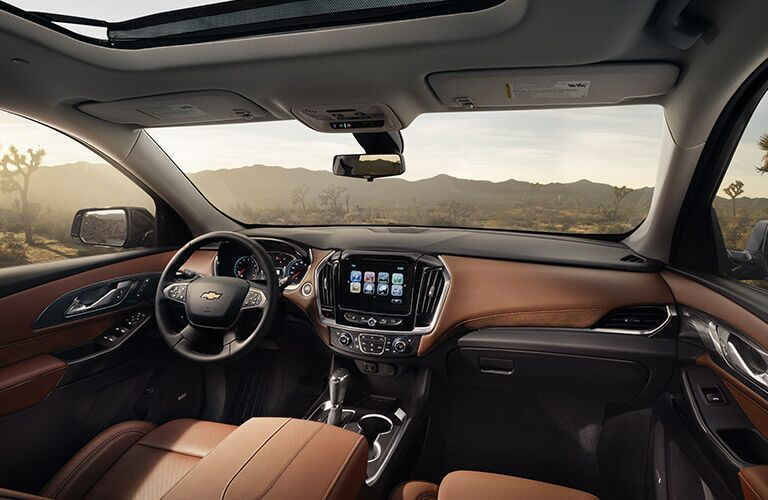 View of front interior of 2018 Chevy Traverse and steering wheel and infotainment touch screen