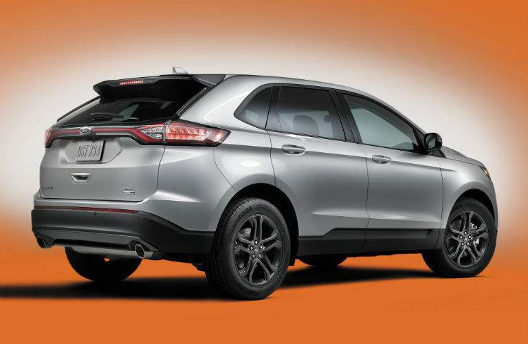 Rear View of Silver 2018 Ford Edge over Orange and White Background