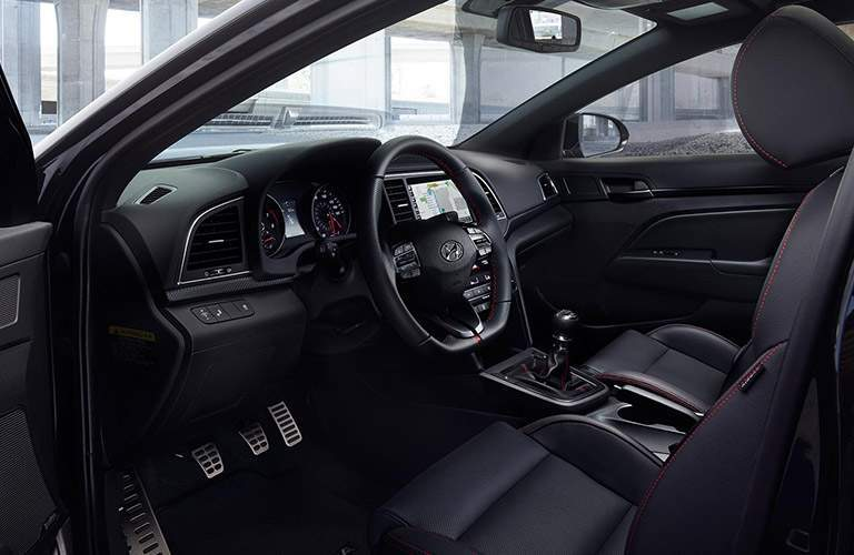 View of 2018 Hyundai Elantra front seat with steering wheel and black interior