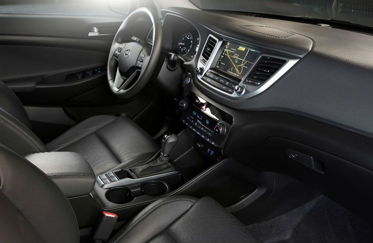 Dashboard and Black Front Seats of 2018 Hyundai Tucson