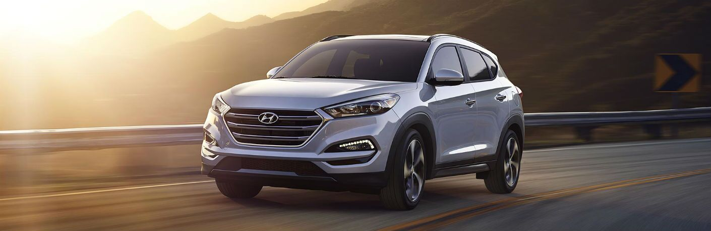 Grey 2018 Hyundai Tucson Driving on a Mountain Road