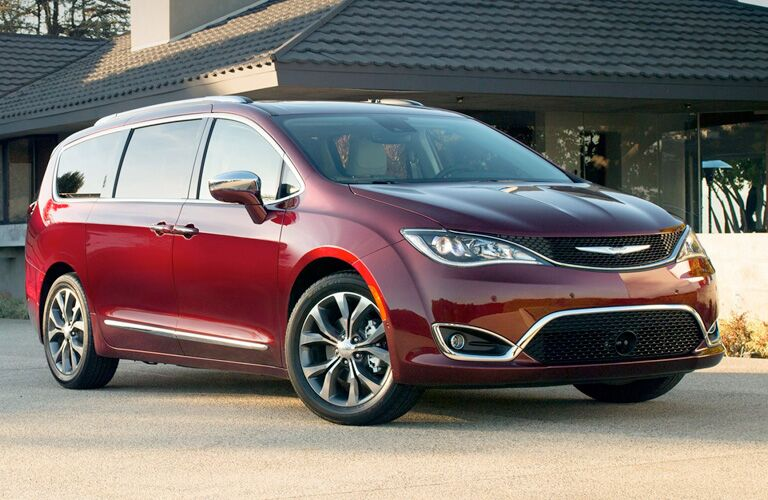 Exterior view of a red 2018 Chrysler Pacifica parked in a driveway