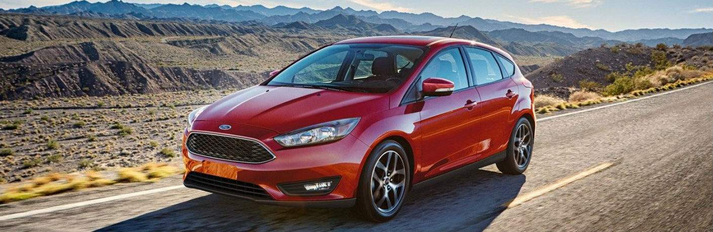 Red 2018 Ford Focus Driving on a Desert Highway