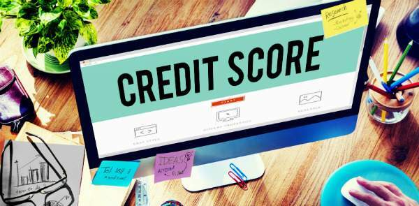 Credit Score Title on Computer Screen and Hand Typing on a Comptuter Keyboard