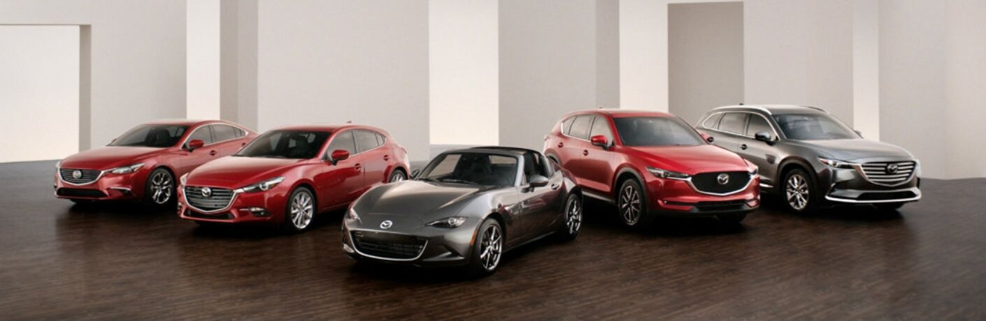 Exterior view of the Mazda model lineup inside a showroom