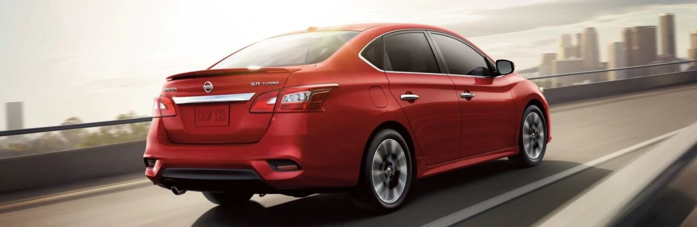 Red 2019 Nissan Sentra driving on highway