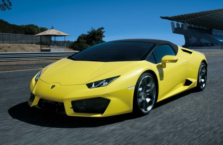 Lamborghini Huracan Spyder RWD yellow front and side view at the track