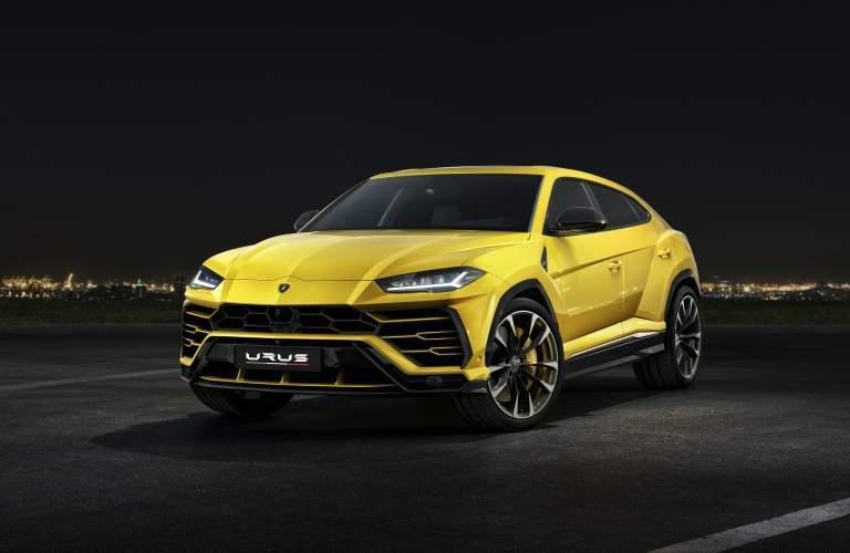 Lamborghini Urus yellow front view black background