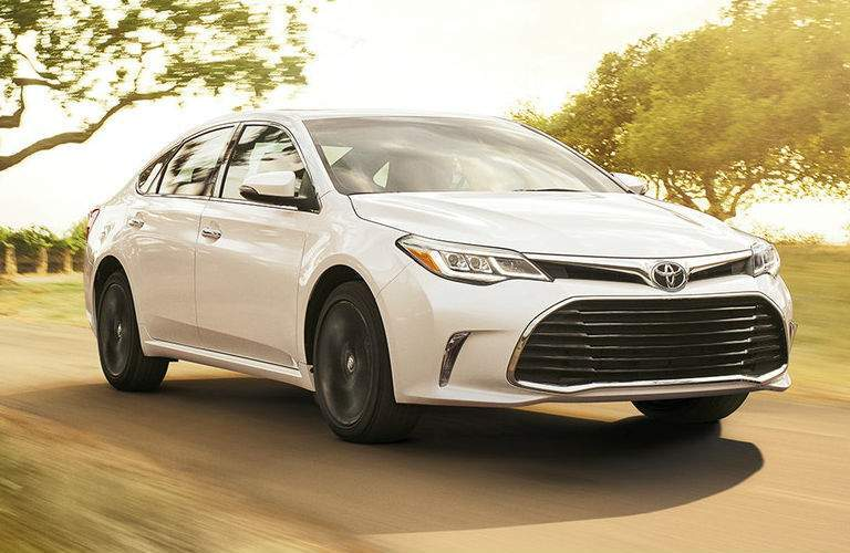White 2018 Toyota Avalon Driving on Country Road