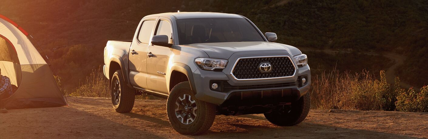 Front passenger side exterior view of a gray 2019 Toyota Tacoma