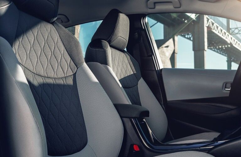 Passenger angle of the front row seats in the 2020 Toyota Corolla