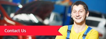 Smiling Mechanic with Red Contact Us Banner