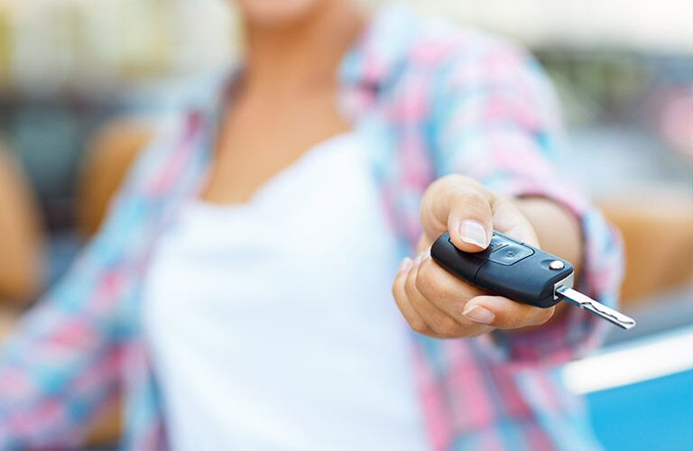 Close Up of Woman's Hand Holding New Car Keys