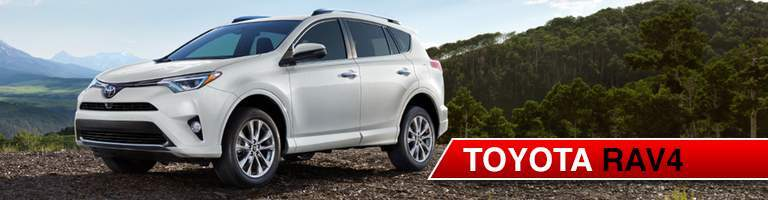 White 2018 Toyota RAV4 in Mountains with Red Banner and Toyota RAV4 Text