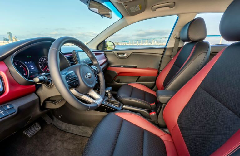 front interior of 2018 kia rio including steering wheel, seats and center console