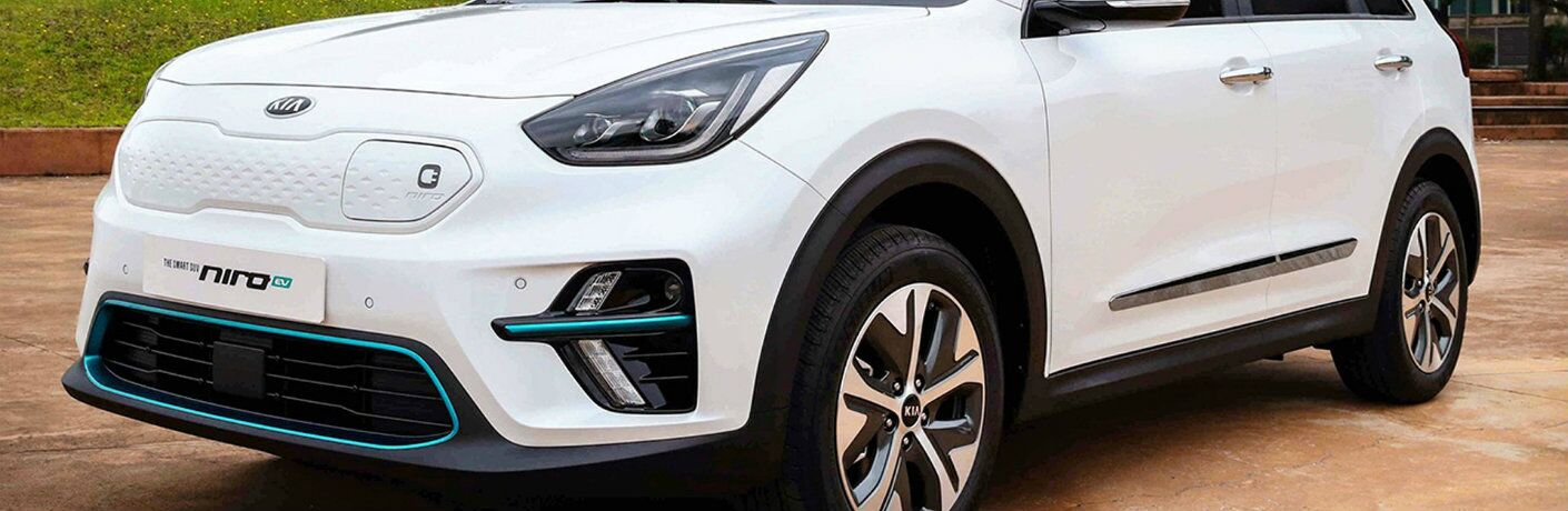 Front shot of white 2019 Kia Niro EV with charging port in view
