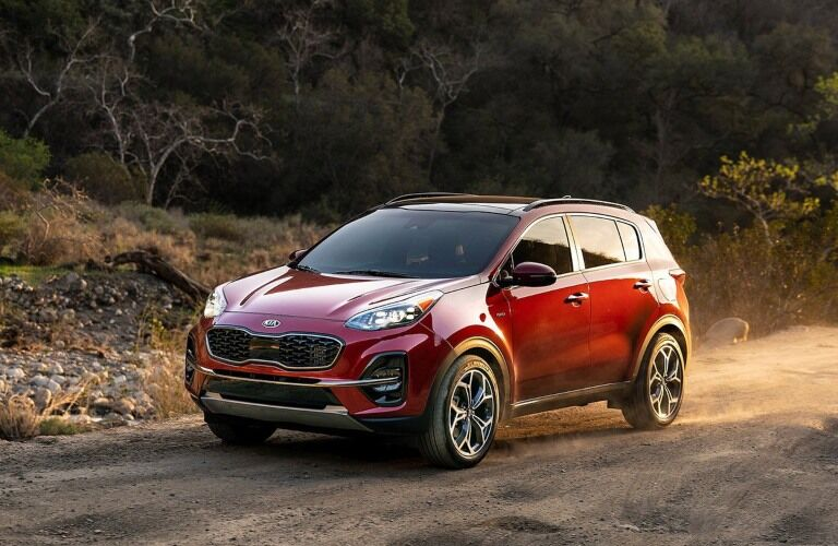 Red 2020 Kia Sportage on dirt road