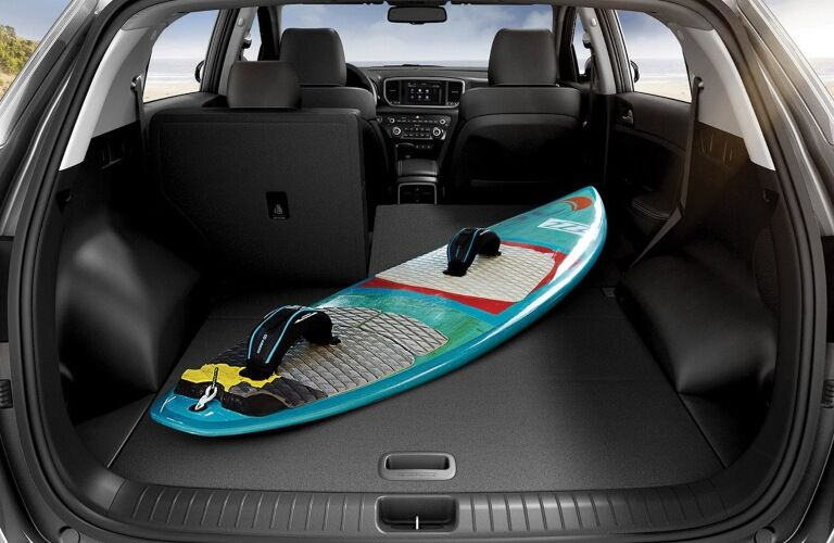 Surf board in the back of 2020 Kia Sportage