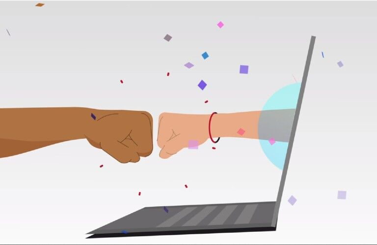 hand out of laptop fist bumping another hand with confetti falling