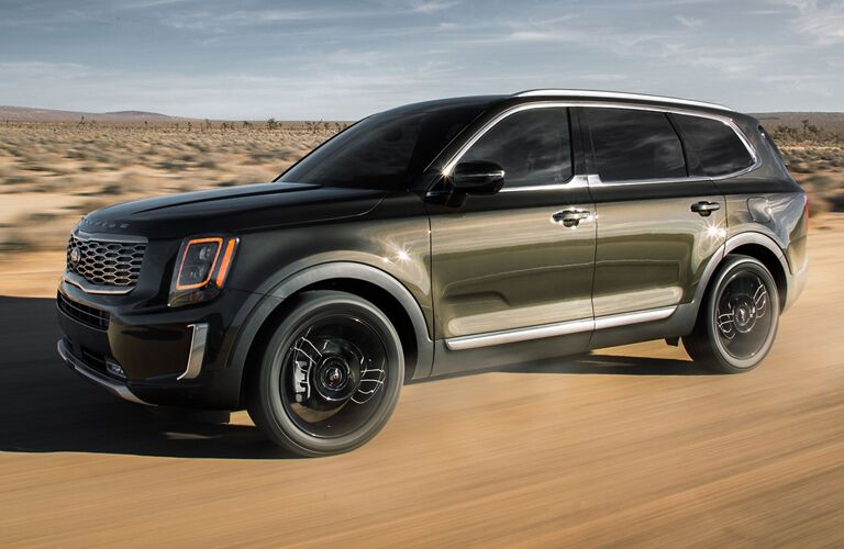 Kia Telluride driving on a dirt road