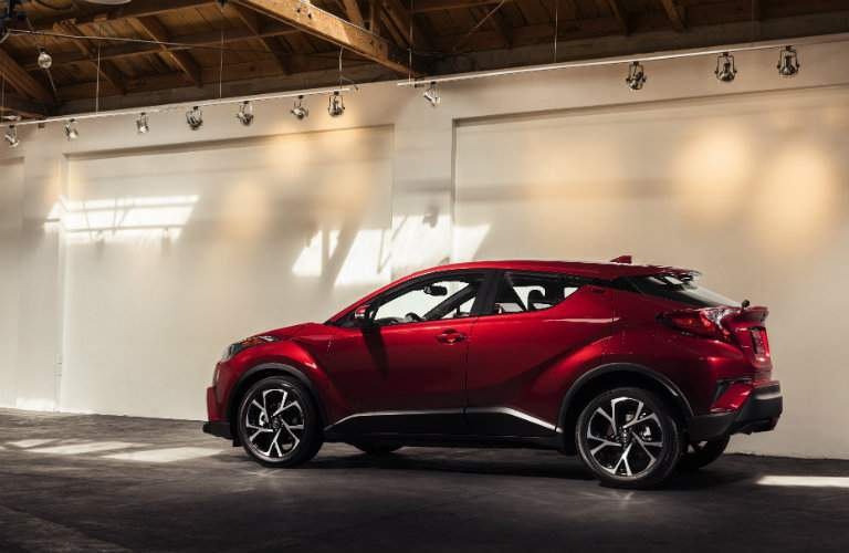 Profile view of red 2018 Toyota C-HR in garage