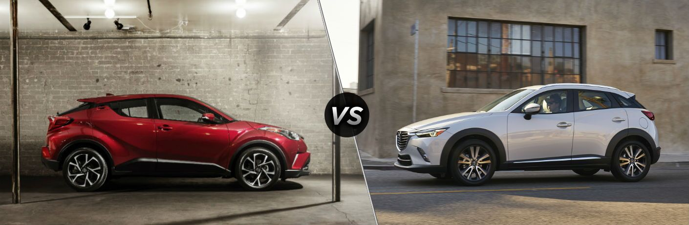 Red 2018 Toyota C-HR facing white 2018 Mazda CX-3 in comparison image