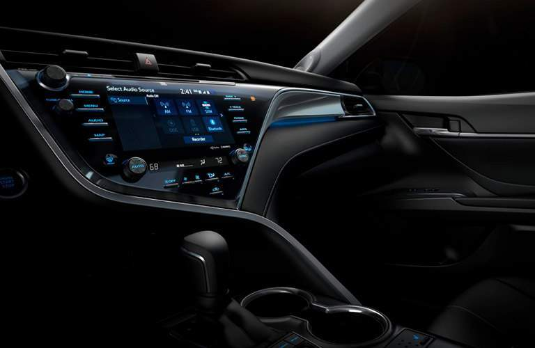 Center touchscreen and flowing lines of 2018 Toyota Camry dashboard