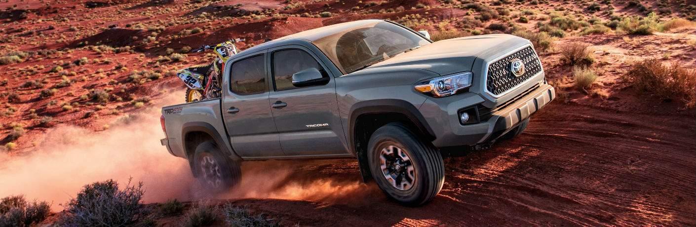 2018 Toyota Tacoma model off-roading on desert terrain in daytime