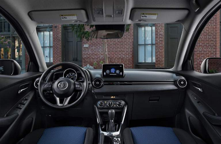 Front row of seating in 2018 Toyota Yaris iA with steering wheel and dashboard prominent