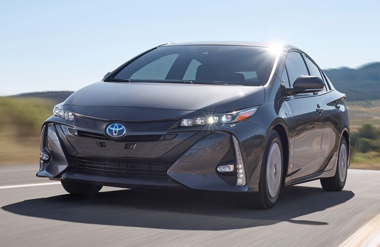 front of 2019 Toyota Prius Prime driving down the road