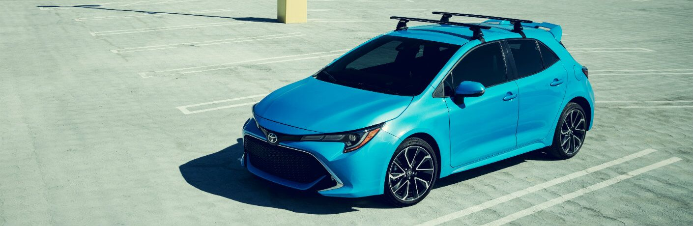Blue 2019 Toyota Corolla Hatchback parked in parking lot in daytime