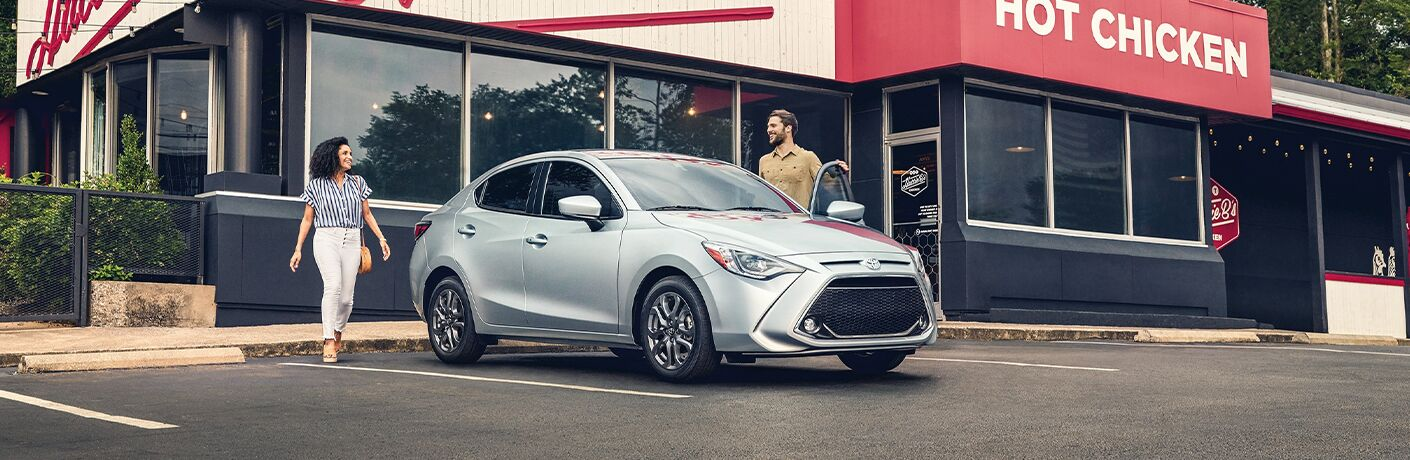 2020 Toyota Yaris parked in front of chicken resturant
