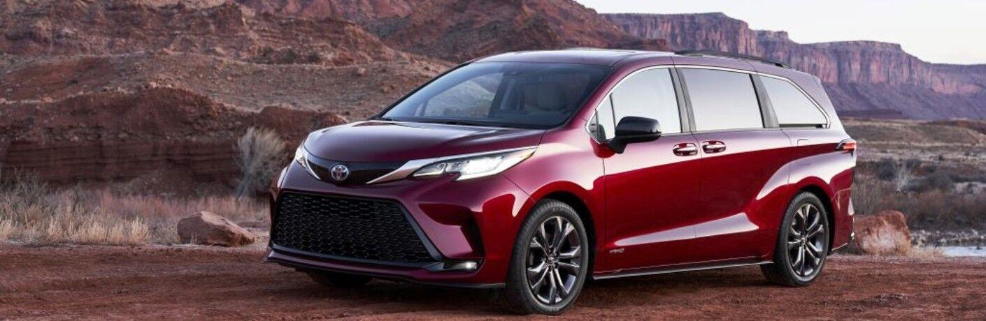 red 2021 Toyota Sienna in desert