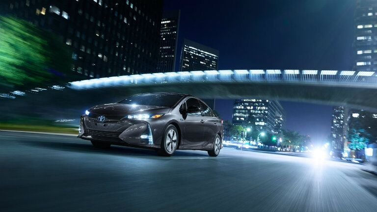 Prius Prime drives under the city lights