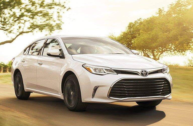 white 2017 Toyota Avalon driving on a sunny day