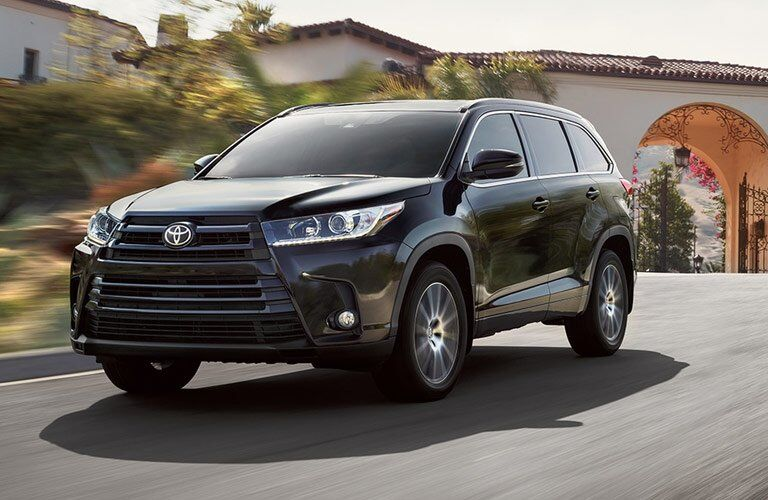 side view of a 2017 Toyota Highlander on the go