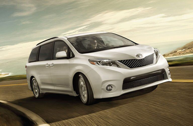 white 2017 Toyota Sienna on the highway