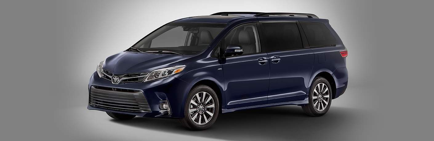 side view of a blue 2018 Toyota Sienna on a grey background