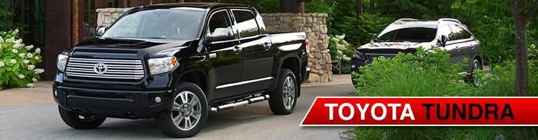 Toyota Tundra black in a driveway