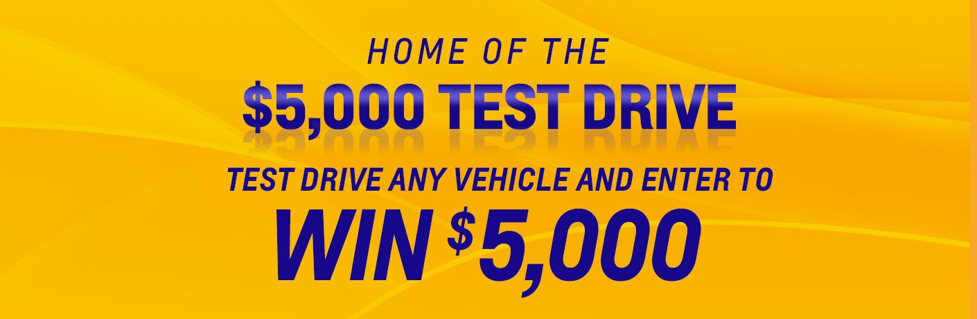 Home of the $5,000 test drive, test drive any vehicle and enter to win $5,000, blue text on a yellow background