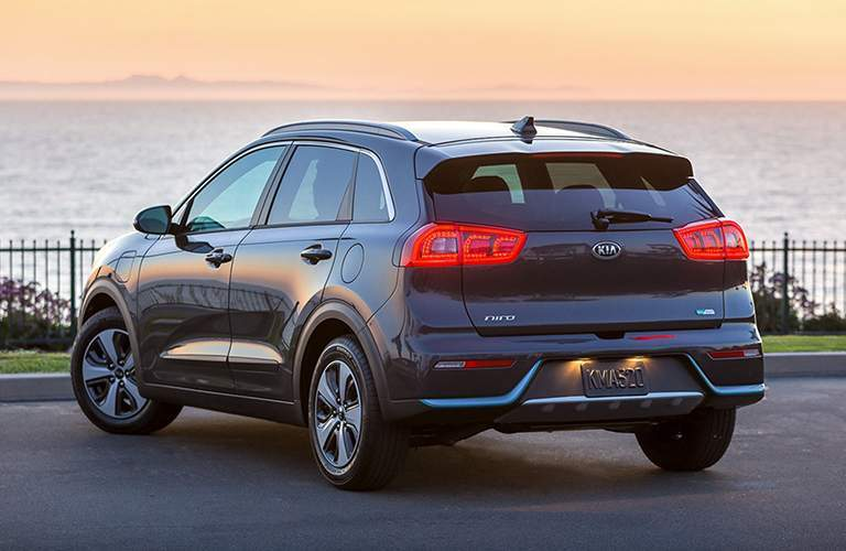 Rear shot of 2018 Kia Niro parked in front of waterfront
