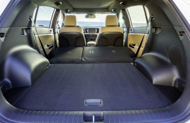 Rear seats folded down inside 2018 Kia Sportage to reveal cargo volume